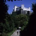 A Man Walks Toward The Salzburg Castle by Taylor S. Kennedy