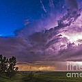 A Massive Thunderstorm Lit Internally by Alan Dyer