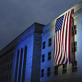 A Memorial Flag Is Illuminated On The by Stocktrek Images