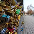A Padlock Filled Bridge In Paris by Rikki Prince
