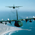 A Pair Of C-130 Hercules In Flight by Stocktrek Images
