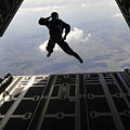 A Paratrooper Salutes As He Jumps by Stocktrek Images