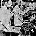 A Pharmacist Demonstrates The Use Of An by Everett