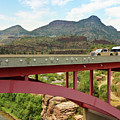 A Pickup Pulling A Travel Trailer Across The Salt River Canyon B by Derrick Neill