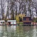 A Raft Houses Moored To The Shoreline Of Ada Medjica Islet by Bratislav Stefanovic