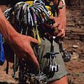 A Rock Climber Check Her Gear by Bill Hatcher