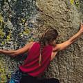 A Rock Climber On A Boulder by Bill Hatcher