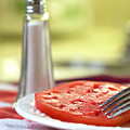 A Slice Of Beefsteak Tomato With Salt by Betty Denise