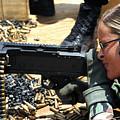 A Soldier Fires An M240b Medium Machine by Stocktrek Images