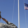 A Soldier Salutes The American Flag by Stocktrek Images
