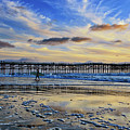 A Surfer Heads Home Under A Cloudy Sunset At Crystal Pier by Sam Antonio Photography