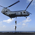 A Trio Of Marines Fast Rope by Stocktrek Images