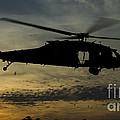 A U.s. Army Uh-60 Black Hawk Leaves by Stocktrek Images