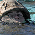 A U.s. Marine Swims Across A Training by Stocktrek Images