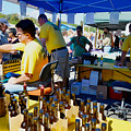 A Vendor At The Garlic Fest Offers Garlic Vinegar And Olive Oil For Sale by Jeelan Clark