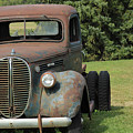 A Vintage Truck On A Yard by Robert Hamm