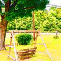 A Wooden Swing Under The Tree by Jeelan Clark