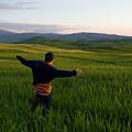 A Young Boy Runs Through A Field by Joel Sartore