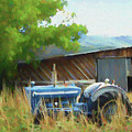 Abandoned Blue Tractor by David King