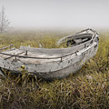 Abandoned Boat In The Grass On A Foggy Morning by Randall Nyhof