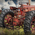 Abandoned Old Farmall Tractor In A Grassy Field by Randall Nyhof