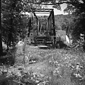 Abandoned Rail Road Trestle Bridge In Black And White by Kelly Hazel