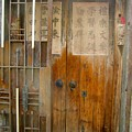 Abandoned Wooden Door With Gate by Kathy Daxon