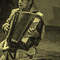 Accordion Player by Totto Ponce