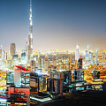 Aerial Panorama View Of Dubai By Night by Dmitrii Telegin