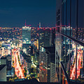 Aerial View Cityscape At Night In Tokyo Japan From A Skyscraper by Michiko Tierney