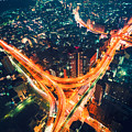 Aerial View Of A Massive Highway Intersection In Tokyo by Michiko Tierney