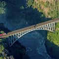 Aerial View Of Victoria Falls Suspension Bridge by Ndp