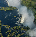 Aerial View Of Victoria Falls With Bridge by Ndp