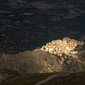 Afternoon Sun Lighting Up Village Of Speloncato In Corsica by Jon Ingall