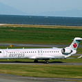 Air Canada Express Crj Taxis Into The Terminal by Darrell MacIver