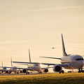 Airplanes Lining Up For Take-off by Raymond Persaud