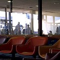 Airport Waiting by Jim Coe