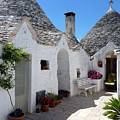 Alberobello Courtyard With Trulli by Carla Parris