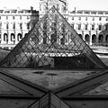 Aligned Pyramids At The Louvre by Donna Corless