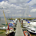 Along C Pontoon In Ryde Harbour by Rod Johnson