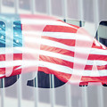 American Flag In Front Of Business Building  by Mariusz Prusaczyk