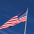 American Flag Waving In The Breeze by John Trax