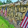 American Flags Along A Stone Cemetery Wall by Lisa Wooten