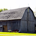 Amish Barn With Gambrel Roof And Hay Bales Indiana Usa by Sally Rockefeller