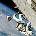 An Astronaut Crawls Along A Truss by Stocktrek Images