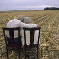 An Elderly Couple Embrace by Joel Sartore