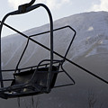 An Empty Chair Lift At A Ski Resort by Tim Laman