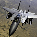 An F-15e Strike Eagle Aircraft by Stocktrek Images