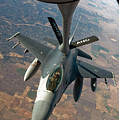 An F-16 Fighting Falcon Receiving Fuel by Stocktrek Images