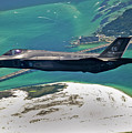 An F-35 Lightning II Flies Over Destin by Stocktrek Images